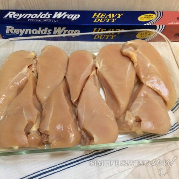 raw chicken breast prepped for oven